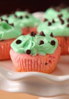 Watermelon Cupcakes -- Bake these pink cupcakes in green liners to make the watermelon-flavored cake look like the fruit too. They're the perfect dessert recipe for summer picnics and parties.