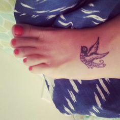 Small sparrow tattoo.