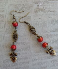 Asymmetrical Heart Earrings for August Challenge .. Made with B'sue brass hearts and red Spectra Beads, Connectors, caps and crystals are from my stash .. Designed by Jann Tague .. Clever Designs .. https://www.facebook.com/JewelsByJann