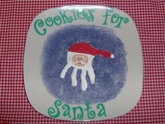 Child's hand print decorates Santa's Cookie plate!