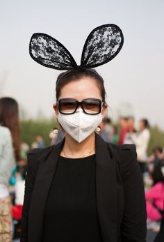 Ive heard face masks are fashion statements in china. I call this one dominatrix mouse.