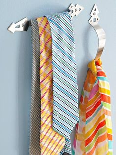 Drawer handles to hold your ties and scarves. This would be great in a closet. via: http://www.bhg.com/decorating/storage/projects/simple-solutions/#page=13
