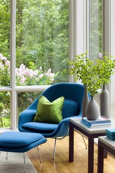Corner seating and a fun turquoise chair.