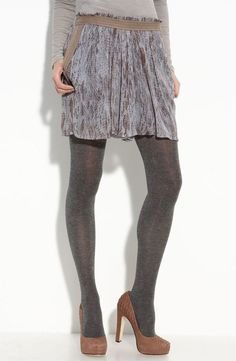 grey tights with brown heels.