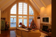 Large windows facing the lake, provide a beautiful view of this Northern Wisconsin lake. The windows where made by Kolbe & Kolbe and custom designed for this home. When we were working on the plans for the home, we had several drafts of what we wanted on the front wall fo the living room. Once the homeowner decided on a design Kolbe made the windows for us. -- I hope you are enjoying all the North Twin Builders pictures and there plenty  more to come. - John