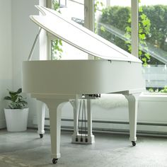 Brown baby grand piano turn white. Click on the image for before picture. #Music #Decor #Style #DIY