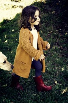 LOVE those wine-colored wellies + mustard cardigan!