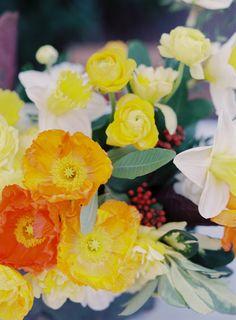 citrus toned flowers, photo by Melanie Gabrielle Photography http://ruffledblog.com/villa-woodbine-wedding-inspiration #weddingflowers #floral