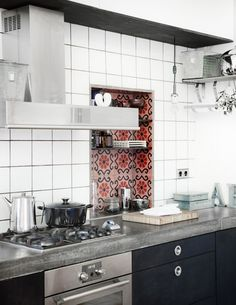 Cement countertops and tile. I also like the mixed shelving (open and cabinets).
