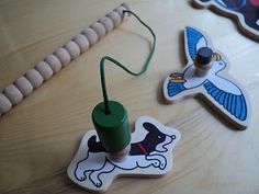 Attach magnets to old puzzle pieces.  Creat a fishing game.