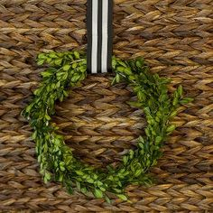 This Simple Boxwood DIY Wreath is ridiculously easy. You'll never guess how they make it!