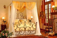Romantic Canopy Bedroom Love the scroll work on wrought iron Head & foot boards..So pretty!