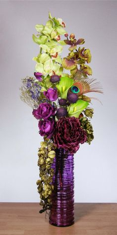 peacock feather arrangements | ... Lime Green and Purple Orchid Floral Arrangement with Peacock Feather