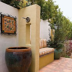 Water-Wise Patio Fountain - A large ceramic urn catches water pumped through a partition to create a simple trickle fountain. The inviting side yard acts as an outdoor extension of a family room. Back Patio, Outdoor Rooms, Seat, Water Features, Spanish Gardens, Side Yards, Outdoor Benches, Backyard, Garden Fountains