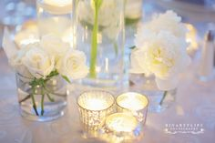 Lots of candles, I like to have at least 9 per table. Wedding by Ambiance Chic Wedding Designs.