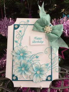 Using totally teal wow powder and blossom stamps
