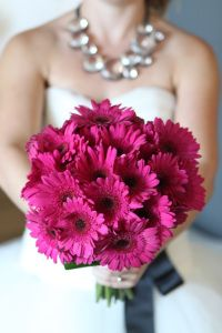 Gerbera Daisies are available year-round from flower farms in California. These fantastic wedding flowers are available in rich and vibrant colors like the hot pink/fuchsia pictured. Shop online at GrowersBox.com.