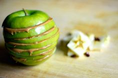 green apple sliced with peanut butter in between