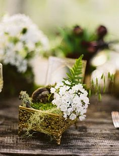 such intricate table flower decor by flowerwild styling by duet weddings.... so precious!!!!!! flowers in a jewelry box!