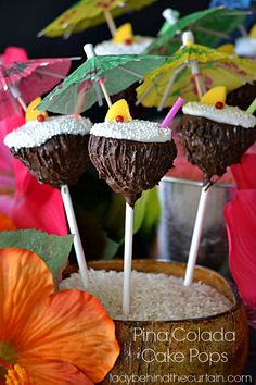 These adorable Pina Colada Cake Pops are sure to bring a smile to your guests.  The inside of the cake pop is made from pineapple upside down cake with a dark chocolate coating for the coconut shell and coconut flavored chocolate to represent the pina colada.  Lady Behind The Curtain