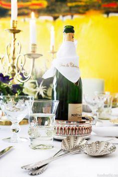 """Julia B. """"Pour le Champagne"""" linen. Antique glasses and serving utensils."""