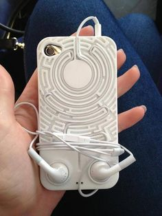 Headphone holder phone cover. This is so cool.