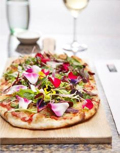 Pizza made with edible flowers