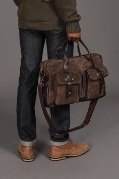Most casual cloths look good with a side of John Varvatos Work Bag.