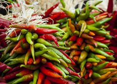Even when summer's over, you can still add garden-fresh flavors to your dishes when you dry and preserve your homegrown herbs and veggies. Click through to learn how to cure and dry onions, freeze fresh herbs, and string and dry chili peppers.