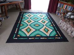 Bargello quilt--love the turquoise and black