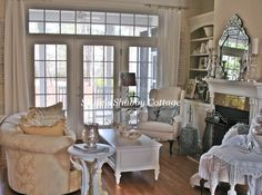 Pretty room~whites and sparkle with venetian mirror and lots of mercury glass