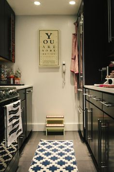 Sarah Azani's DC Home Tour // kitchen styling // black cabinets // wall art // photography by Yvonne Rock