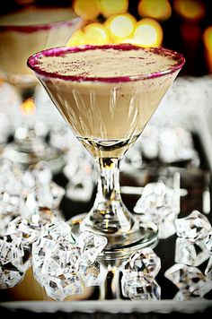 ☆ Glitter Godiva Mudslide Martini: 2 ounces chilled Godiva Chocolate Vodka, 2 ounces chilled Bailey's Irish Cream liquor, 1 ounce cold milk, 2 scoops vanilla ice cream, 2 Tablespoons Chocolate Syrup, Place all ingredients into a blender. Blend until smooth. Pour into martini glasses. If desired, dust rim with edible glitter ☆