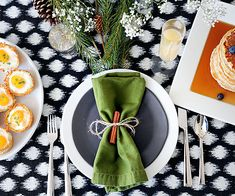 Something as simple as a cinnamon stick or spring of rosemary tied to each napkin can go a long way to help add a festive pop to your holiday table.