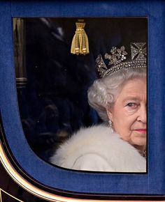 Britain's Queen Elizabeth II returning to Buckingham Palace in central London after addressing Parliament during the official State Opening of Parliament ceremony at Westminster on Nov. 18, 2009.