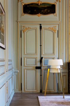 Wall Treatment - Blue walls accented with gilded molding