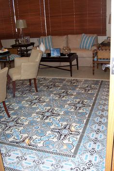 Cuban tile #rug takes center stage in a contemporary living room
