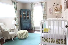 The antique furniture is perfectly balanced with the modern fabrics and colors. #nursery