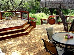 Beautiful multi-level deck.  Love the planter near the stairs.