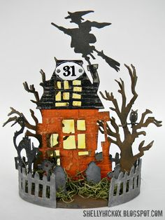 Design team member @Shelly Hickox created this fun dimensional Halloween decoration featuring dies by Tim Holtz. You can find the tutorial on our blog: http://sizzixblog.blogspot.com/2012/10/die-cutting-paper-spooky-halloween-house.html.