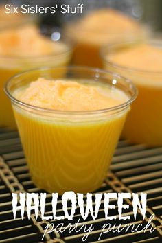 Halloween Orange Party Punch from SixSistersStuff.com.  The perfect punch for your Halloween parties!  Your guests will love it! #recipes #halloween #punch #drink