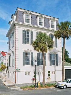 Federal Meets French Style - Built in Federal style in the 19th century, this early American home was heavily influenced by French architecture. The home boasts French blue shutters, tall windows capped with window lintels, and cozy dormers on its uppermost level.