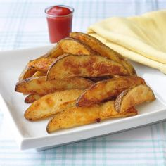 Unfried Crispy Wedge Fries - learn the secret to making super crispy, lower fat baked wedge fries that folks are gonna swear were deep fried.
