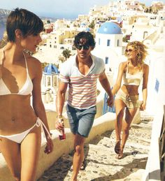 looks so fun - back drop greece...swimsuits + hand holding