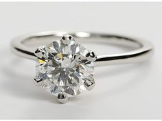 Blue Nile Jewelers - Petite Nouveau Solitaire Engagement Ring in Platinum.