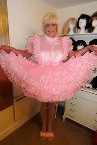 Beautiful sissy maid in her wonderful sissy maid frilly dress