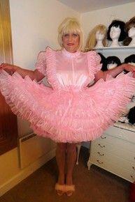 Beautiful sissy maid in her wonderful sissy maid frilly dress