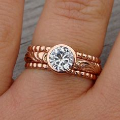 Moissanite and recycled 14k rose gold engagement/wedding rings