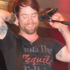 Heads up, David Cook! Your tats are showing. ; P