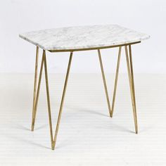 Gold leafed hairpin side table with solid white marble top. Natural color variations are to be expected within the marble.